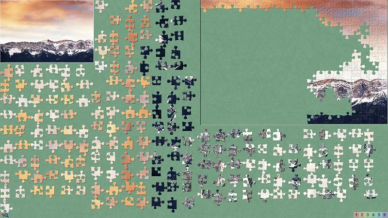 A BrainsBreaker puzzle with the pieces scattered by color, the new feature.